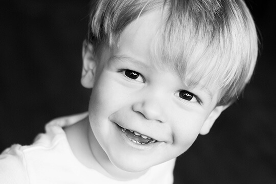 Smiling toddler boy with healthy teeth