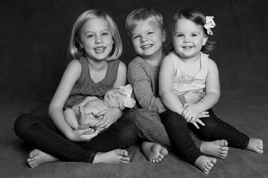 Four adorable kids smiling