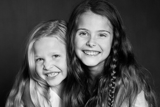 Two girls smiling broadly