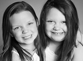 Two cute little girls smiling