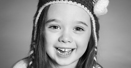 Smiling girl with knit hat